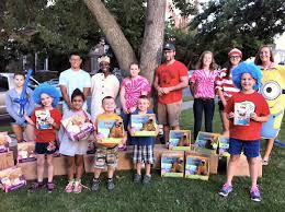 bookmobile student volunteers in literary character costumes purchased with funds from an oswego city county
