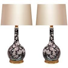 pair of black ground famille verte porcelain lamps 1
