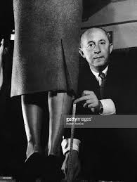 French Designer Christian French Fashion Designer Christian Dior Demonstrates With A