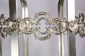 this is a fascinating antique lantern style six light chandelier in its original silver plate dating from the early 1900 s this neoclassical chandelier