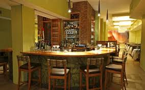 engaging country wine bar and basement interior with brick walls and curved  bar counter