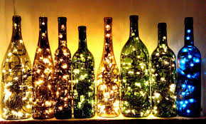 wine lighting. Blue Chardonnay Bottle Filled With Tea Lights Will Add A Festive Touch To Your Side Table. Here Are Five Of Our Favorite Ways Upcycle Wine Bottles: Lighting T