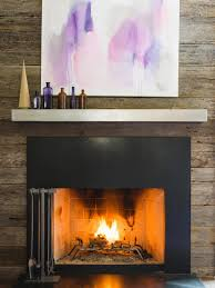 silver steel mantel shelf with black fireplace on grey stone wall fascinating steel