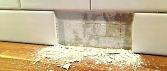 master bathroom shower before removing tile from wall without breaking