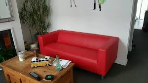 brand new 3 seater 2 seater red leather effect sofas still in packaging