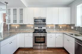 grey and white tile backsplash white cabinets grey kitchen subway tile white subway tile backsplash