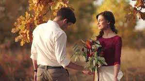 stylish and romantic caucasian couple in sunlight in beautiful autumn park love relationships romance happiness concept bouquet in s hands