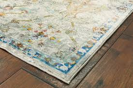 this gala area rug brings victorian elegance into the modern era featuring botanical swirls in