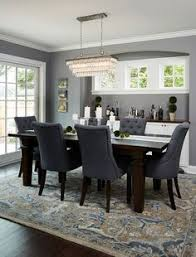 blue grey dining rooms. Dining Room With Dark Wood Floors, Beautiful Patterned Rug And Blue Chairs Grey Rooms