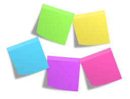 Pink Green Yellow Blue And Purple Sticky Note Mounted On White