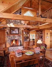 main living area of custom log home with fireplace and cathedral ceiling cape cod design