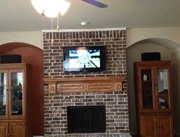 mount tv above brick fireplace