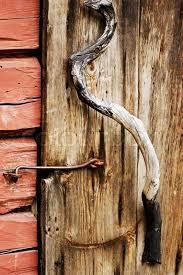 close up of juniper wooden door handle on very old door stock photo colourbox