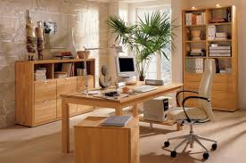 home office interiors. Captivating Room Design Inside Office Which Has Cream Colored Stoned Wall Also Neat Bookshelves Below Twin Human Figures Teak Home Furniture Interiors