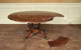 classic formal antique reion dining table with perimeter leaves seats 4 to 8