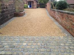 Driveway Ideas- A stone cobbled 'rumble strip' idea between the gravel and  the pavement & road