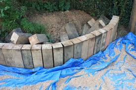 the old bakehouse s curved retaining wall from reclaimed oak railway sleepers