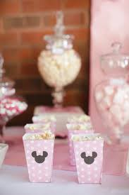 party guests enjoyed an array of pink and white sweet treats including custom minnie mouse cookies by gracie s goos the personalized minnie printables