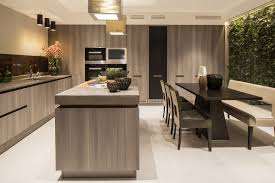 A Lovely Kitchen With A Wall Of Light Gray Minimalist Cabinets To One Side,  And