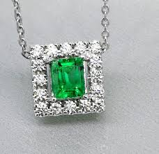 diamond pendant with a natural 0 50 ct columbian cut green emerald with i g i certificate and 16
