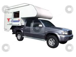 Pickup truck with camping trailer stock photo