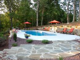 best pool patio materials freeform pool with concrete deck