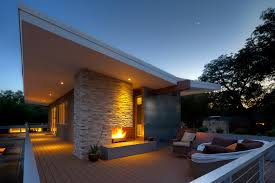 outdoor living outdoor fireplace concrete erfly roof second story addition remodel