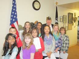 meadowdale middle school student among winners in vfw essay  commander jim blossey at right in back row congratulates the recipients of the vfw