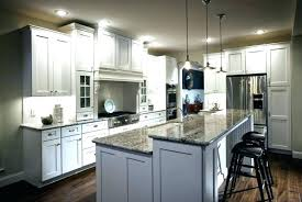 kitchen with black countertops and white cabinets with white cabinets and black white cabinets with granite kitchen with black countertops