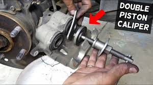 HOW TO COMPRESS DUAL PISTON CALIPER WITH A SINGLE PISTON TOOL - YouTube