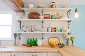 eclectic kitchen design with mix country industrial open shelving in white l shape butcher block countertop