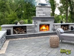unilock paver patio outdoor fireplace
