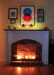 i think i want a fake fireplace shhh don t tell chris light your fire 7 faux fireplace ideas for a hearthless home