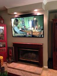 tv mounting fireplace ideas photo pro av home theater ca united states mounted hanging over without