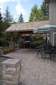 covered patio idea with built in grill attached to the garage cost to build outdoor kitchen