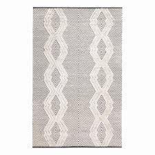 cream rug with black diamonds