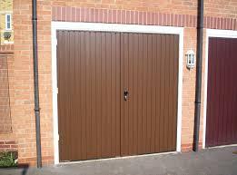 3 brown side hinged roller shutter doors