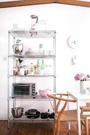 storage shelves kitchen how to style wire shelves for a living space kitchen styling by shelving