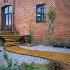 Small Picture Garden Pathways On a Budget Decked path Garden decking design