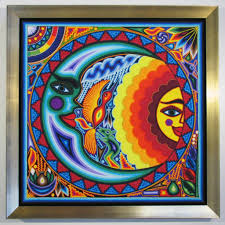 mexican string art sun and moon framed in gold