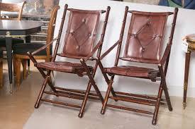 set of twenty leather bamboo style folding chairs