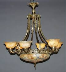 a fine french art deco medium size bronze and veined caramel alabaster six light chandelier circa 1900