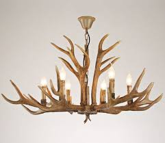 living wonderful faux antler chandelier white 2 appealing above wooden chair faux large