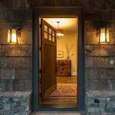 open front door and outdoor sconces