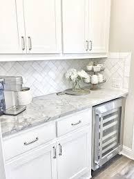 small butler s pantry with herringbone backsplash tile