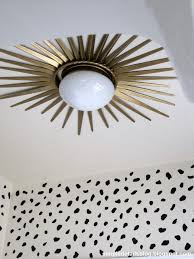 install a starburst mirror frame around a flush mount ceiling light for a dramatic makeover