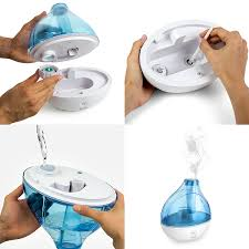 This Is Great Humidifier. It Is Easy To Set Up And Works Right Away. It Is  Beautiful Blue Light In Dark Room. It Comes With A Cleaning Brush For The  Base ...