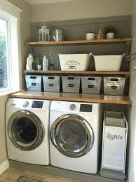 Laundry room makeover. Wood counters, Walmart tin totes, pull out laundry  bins