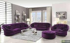 furniture modern living room with purple velvet tufted sofa and clear glass top chrome coffee table
