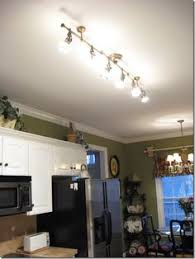 overhead kitchen lighting ideas. Brilliant Ideas Pretty Track Lights Antique Brass Finish With Adjustable Spotlights From  Lowes To Replace Fluorescent Overhead Light Fixture In Kitchen Intended Overhead Kitchen Lighting Ideas E